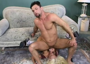 Stacked blond in white stockings gets pounded steadfast by two hung studs