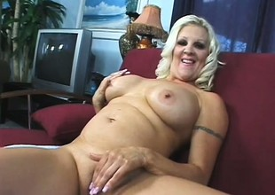 Big breasted kirmess mom Veronica Vaughn is in need of a stiff cock deep in her cum-hole