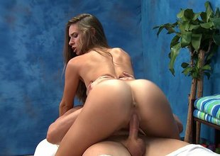 Massage gal Bridget sliding on a shlong