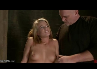 Blond in wooden clamps gets pussy stimulation
