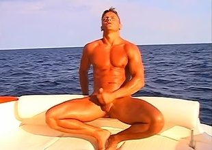 Leslie Manzel relaxes alone in a giant rubber raft, satisfying himself below the ocean's sun, in this 8 minute solo scene.  If outdoor scenes are serene, there's no thing that suspends time quite allied to a gorgeous rod not far from a chubby cock, stroking himself on th