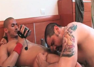 Tattooed gay sucking dick