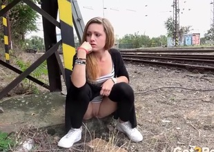 Girl takes a piss by be passed on train tracks