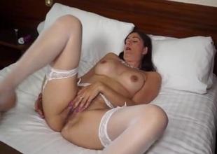 Nice-looking white stockings on a masturbating milf