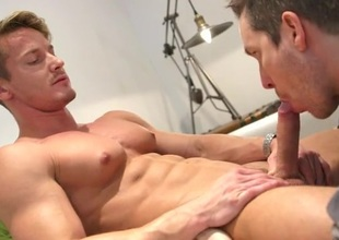 Muscle god enjoys a sexy sucking indiscretion on his dick