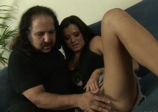 Ron Jeremy watches a slim cutie shed one's clothes for him