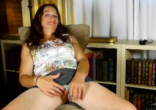 Chatty mature honey Ann shows us the brush grey pussy