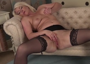 Curvy milf in nylons and a garter belt masturbates