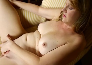 Cute mature blonde fingers and fondles simply