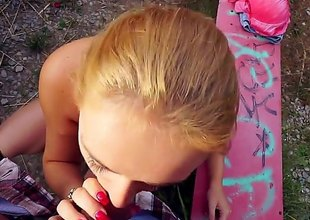 Paris Sweet is a busty blonde that's naked in public and she is sucking a cock. She's also massaging it with her boobs as she is giving it a blow job.