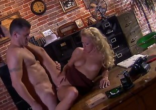 Chap in hat Randy Spears has unforgettable sex in office with beautiful blonde Cassie Young. She eats his lasting dick with appetite and then gets her neatly trimmed pussy royally fucked.