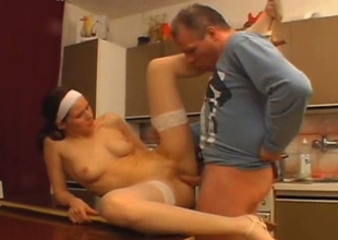 Spoiled nympho in white stockings gets fucked superior to before the dining table
