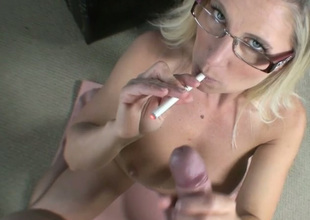 Nerdy buxom and pale blonde haired MILF kneels down to give BJ