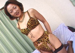 Horn-mad short haired Japanese MILF teases her clitoris with tiny vibrator