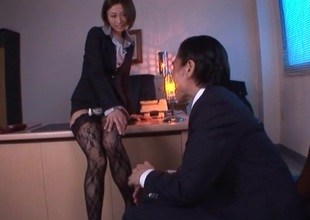 Lustful Brunette in nylons rides the brush boss cock doggy style