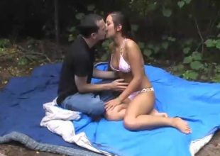 Sensuous brunette pornstar with a nice ass gets pounded hardcore outdoors