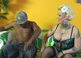 Tattooed cowgirl monster nailed in an interracial sex