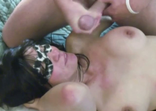 Brunette mom wearing a mask sucks a ramrod and gets facialed