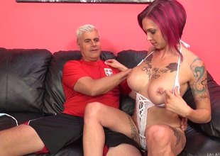 Tattooed redhead with giant titties get thoroughly bonked with a monster cock in a reality shoot