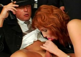 Chesty redhead has her face coated around nut butter at a hardcore gang bang action