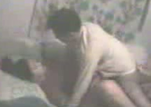 Impassioned Indian couple is having missionary style coitus