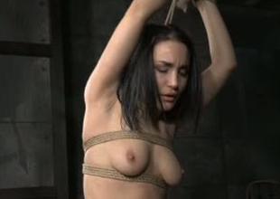 Beautiful girl Gabriella Paltrova is bound beside in BDSM video