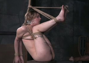 Golden-haired strumpet Clemency West is duct taped and promised