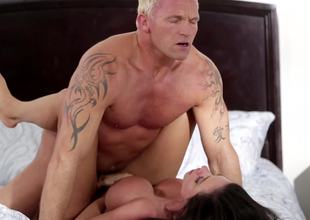 A blonde dude is pushing his cock into a hot and hot milf