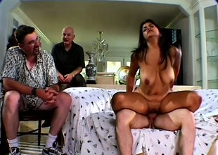Buxom brunette Mrs Walters gets fucked at the end of one's tether a trestle in front of her man