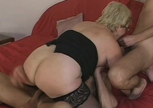Lusty grandma acquires doubled roasted by 2 horny young stallions