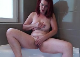 Large booty older redhead rubs her hot holes