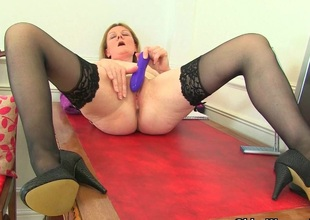 British milf Clare strips off her secretary paraphernalia and plays