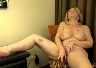 Chesty mature cosset gets stripped and fucks a toy