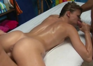 Masseurs double team the oiled up cutie