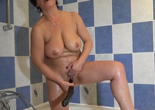 Beamy black dildo up her wet mature pussy
