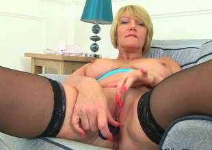 British milf Funereal strips off and teases her pussy