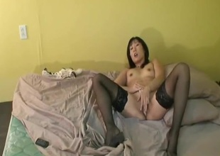 Camgirl in hot white lingerie and stockings plays solo
