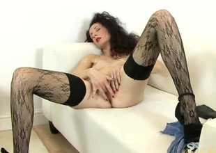 Elegant unshaved hair milf is stunning in stockings