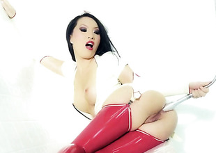 Asa Akira in latex nylons plays with her holes