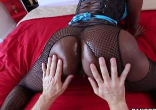 Dark skinned MILF in fishnet pantyhose puts her big perfidious ass on expose and then gets ehr throat filled with hard white dick. This babe sucks harmless guys ivory schlong like a pro!