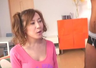 Sexy Japanese girl in pigtails and thigh high nylons sits on her man