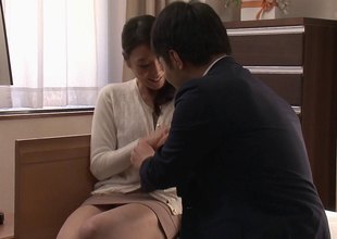 Yukie pulls her panties aside and lets him drill her unfathomable