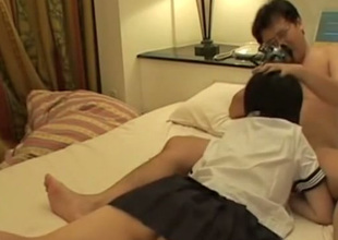 Short haired Japanese coed girl gives BJ and gets poked man of the cloth