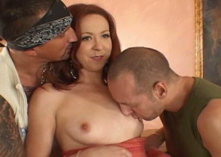 Redheaded bitch gets two cocks to satisfy her licentious long