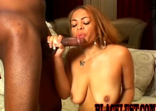 Ebony babe riding a beefy black cock doggsytyle in a close up video