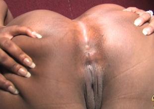 Loving ebony chubby with big ass giving huge dick handjob through gloryhole