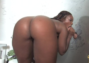 Glamorous ebony close to big bosom giving big schlong handjob during the time that displaying her black butt