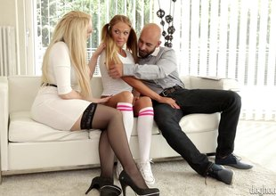 College coddle with pigtails joins a couple for a trio moistness sexual encounter