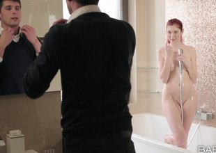 Glamorous redhead getting plowed doggy style in the bath