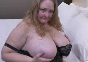 British giant breasted mature Lindy Lust gets wet and wild